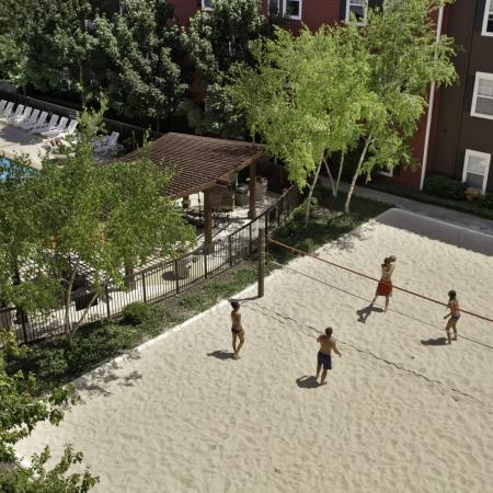 sand volleyball court at The Commons on Kinnear Apartments in Columbus