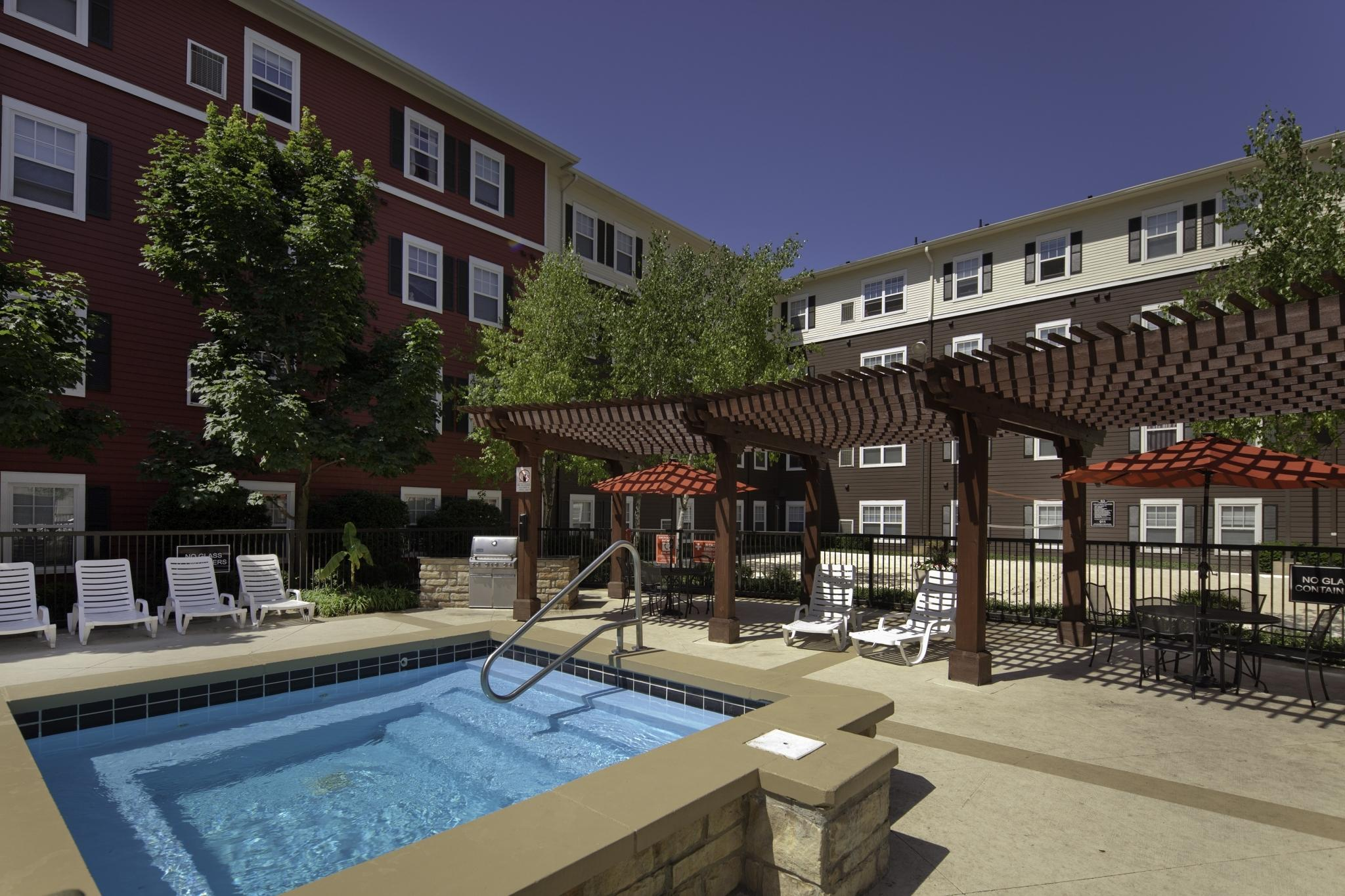 Hot tub and covered lounge seating at The Commons on Kinnear