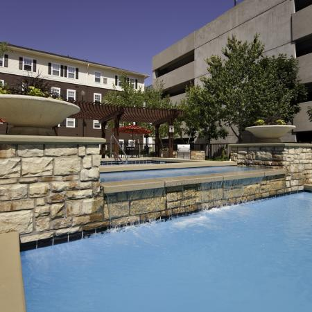 Hot tub and pool with water feature at The Commons on Kinnear