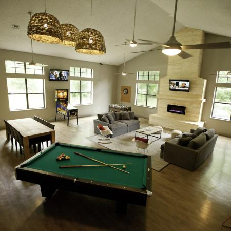 Game room with pool table, TV, and pinball at The Pavilion on 62nd