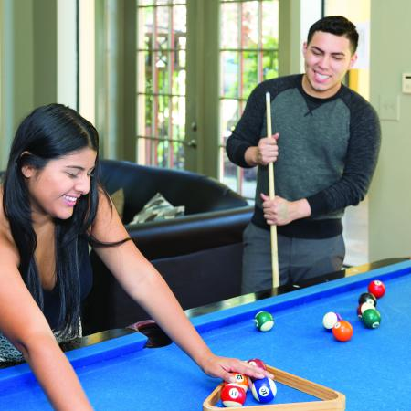 Residents Playing Billiards   Student Housing FSU   The Commons at Tallahassee