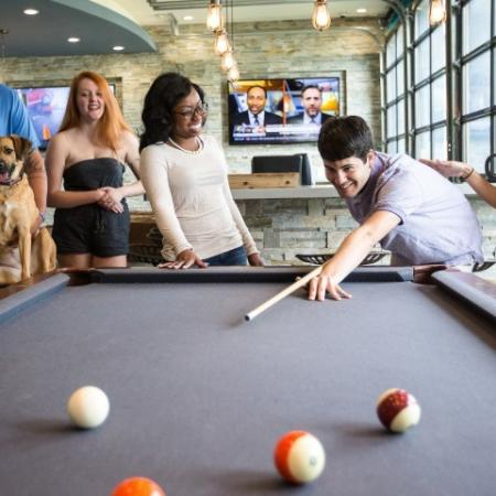 Residents Playing Billiards | Apartments ECU | The Landing