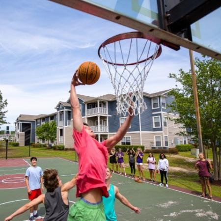 Residents Playing Basketball | ECU Apartments | The Landing