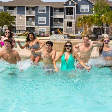 Playing in the Pool | Apartments ECU | The Landing