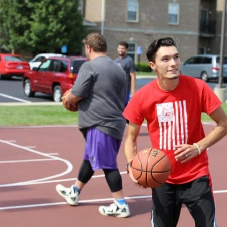 Residents Playing Basketball | Apartment Homes In Muncie | The Haven