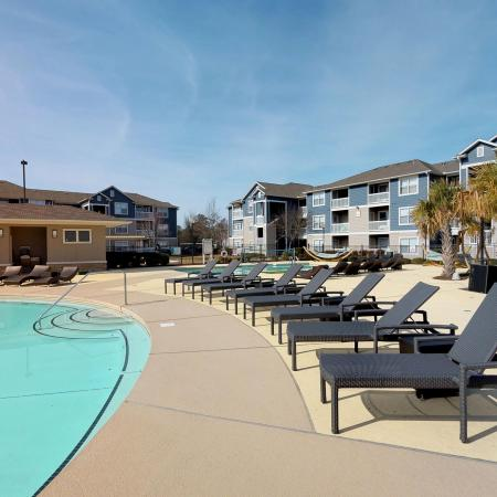 Lounging by the Pool | Apartments Near ECU | The Landing