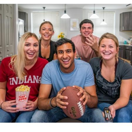 Residents Lounging in the Living Area | ISU Bloomington Off Campus Housing | Smallwood Plaza