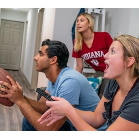 Residents Lounging in the Living Room | ISU Campus Apartments | Smallwood Plaza
