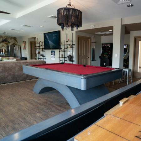 Pool and shuffleboard tables in The Junction at Iron Horse lounge