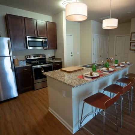 Kitchen with stainless steel appliances at The Junction at Iron Horse
