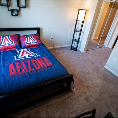 Bed with University of Arizona bedding at The Junction at Iron Horse