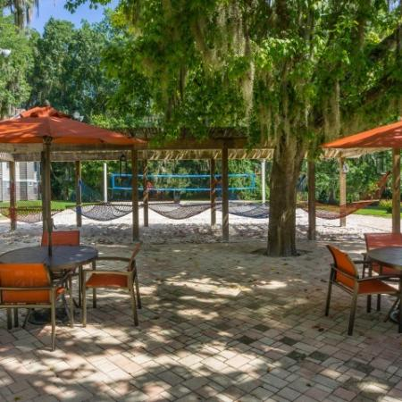 Hammock lounge and sand volleyball court at The Pavilion on 62nd