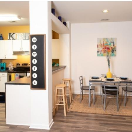 Open Dining Room to Kitchen with bar seating | The Lodge on the Trail Apartments