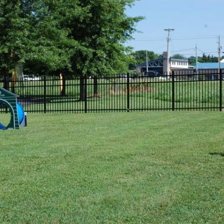 Dog park with agility equipment | Hilltop Club Apartments in Bowling Green