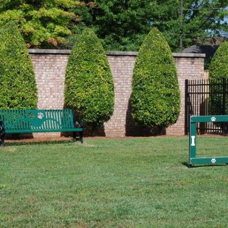 Dog Park with agility equipment and bench | Hilltop Club Apartments
