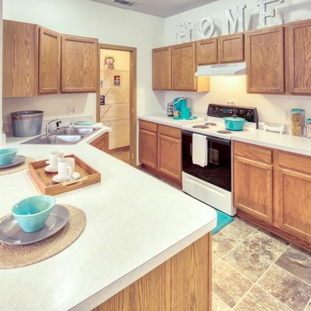 Open Kitchen with Large Pantry for Food Storage | South Duff Apartments near ISU