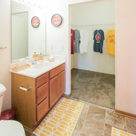 Bathroom with tub shower and walk-in closet | South Duff Apartments Ames IA