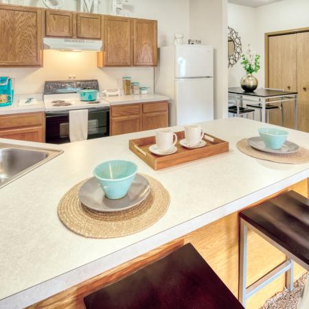 Spacious Kitchen with Chef's Island and Bar Seating | South Duff Apartments near ISU