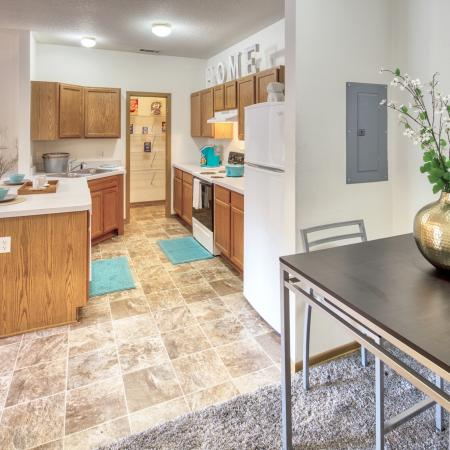 Open Concept Floor Plan with Dining Space and Kitchen with Bar Seating | South Duff Aparments
