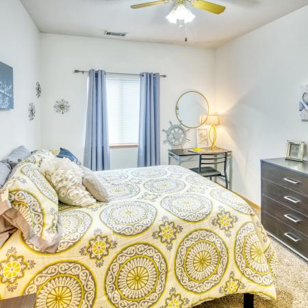 Fully furnished bedrooms with room for a desk | South Duff Apartments Ames IA