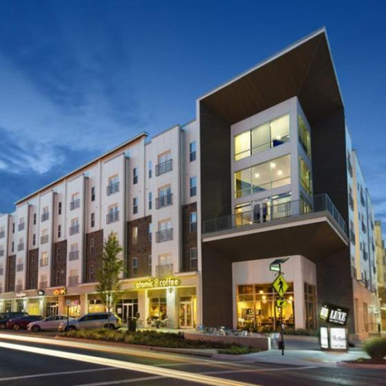 The Luxe on West Call, exterior, four level building, night, street