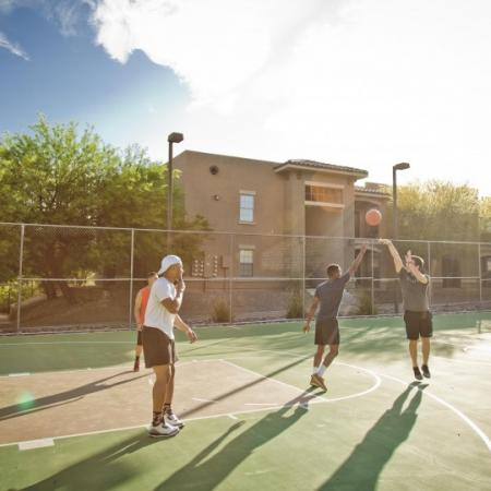 students playing basketball at ua off campus housing complex