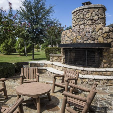 Outdoor Fireplace with Sitting Area   Rock Ridge Apartment Homes Arlington, TX