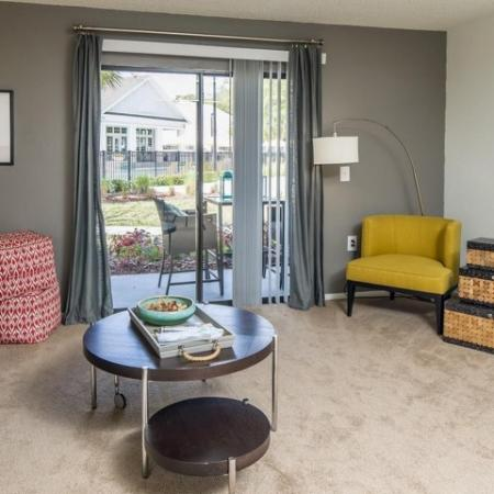 The Glenn-Interior | Living Room with sliding door to the patio