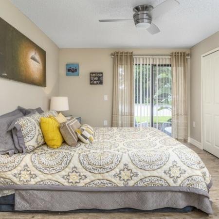 The Glenn-Interior | Bedroom with sliding door to patio