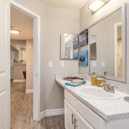 The Glenn-Interior | Bathroom with large mirror, plenty of counter space and medicine cabinet