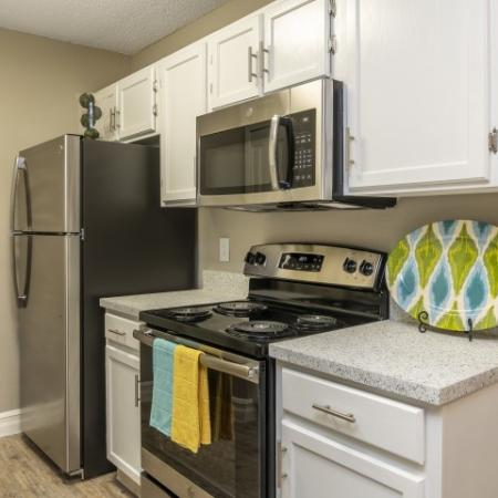 The Glenn-Interior | Kitchen with Stove, Microwave and Refrigerator