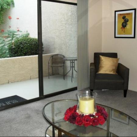 Living room and patio at SunVilla Apartments In Mesa, AZ