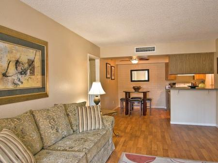 Living room and dining area at Papago Crossing Apartments in Phoenix, AZ