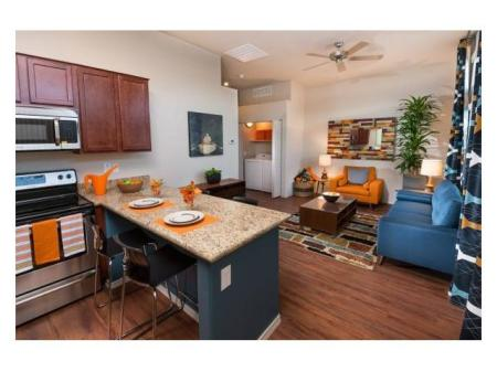 Dining area and living room at Casitas at San Marcos 1 Apartments in Chandler, AZ