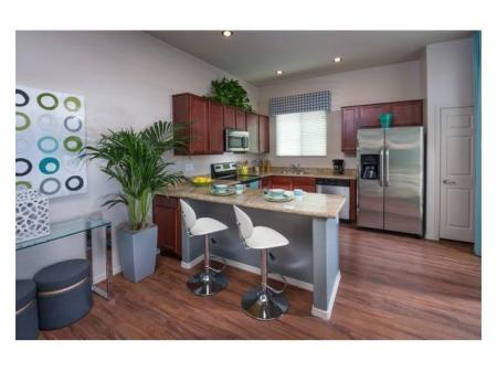 Dining area and kitchen at Casitas at San Marcos 1 Apartments in Chandler, AZ