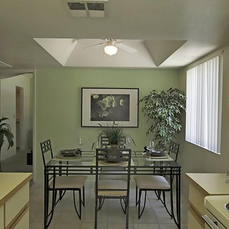 Kitchen and dining room at Bell Tower Apartments in Phoenix, AZ