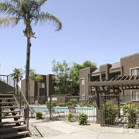 Pool and patio area Bell Tower Apartments in Phoenix, AZ