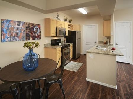Dining area and kitchen at Silverbell Springs Luxury Apartments in Tucson, AZ