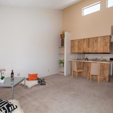 Living room and kitchen at Acacia Gardens Apartments in Tucson, AZ