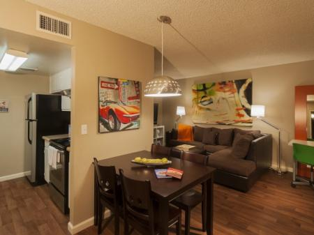 Kitchen, dining area and living room at Zona Verde Apartments in Tucson, AZ