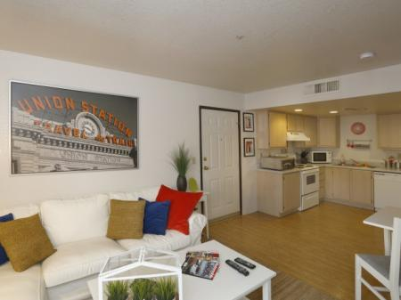 Living room and kitchen at University West Apartments in Flagstaff, AZ