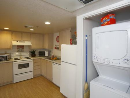 Kitchen and laundry at University West Apartments in Flagstaff, AZ