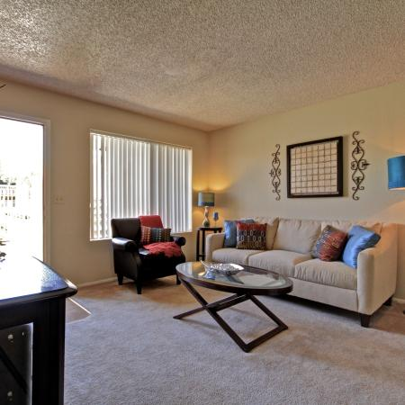Living room at Acacia Pointe Apartments in Glendale, AZ