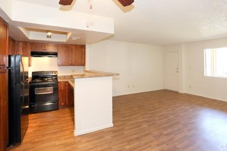 Kitchen, dining area and living room at Avalon Hills Apartments in Phoenix, AZ