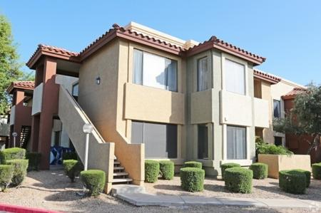 Exterior and landscaping at Country Brook Apartments in Chandler, AZ