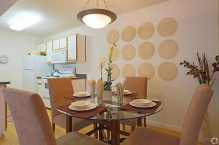 Kitchen and dining area at Mirabella Heights in Albuquerque, NM