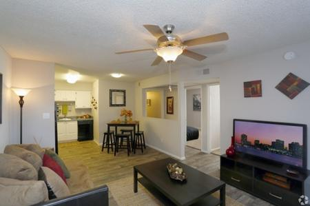 Living room and dining area at Park At Deer Valley Apartments in Phoenix, AZ
