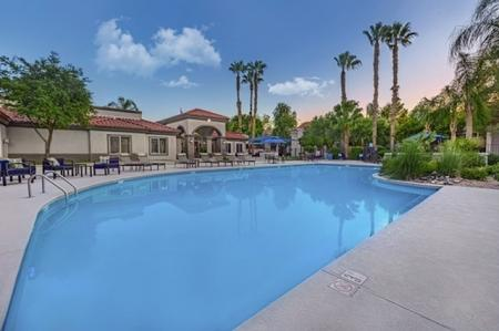 Pool and patio at Springs At Continental Ranch Apartments In Tucson, AZ