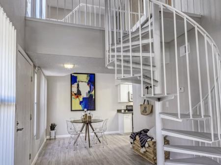 Dining area and stairway at La Entrada Apartments in Tucson, AZ