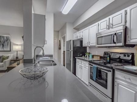 Kitchen and breakfast bar at Springs At Continental Ranch Apartments In Tucson, AZ